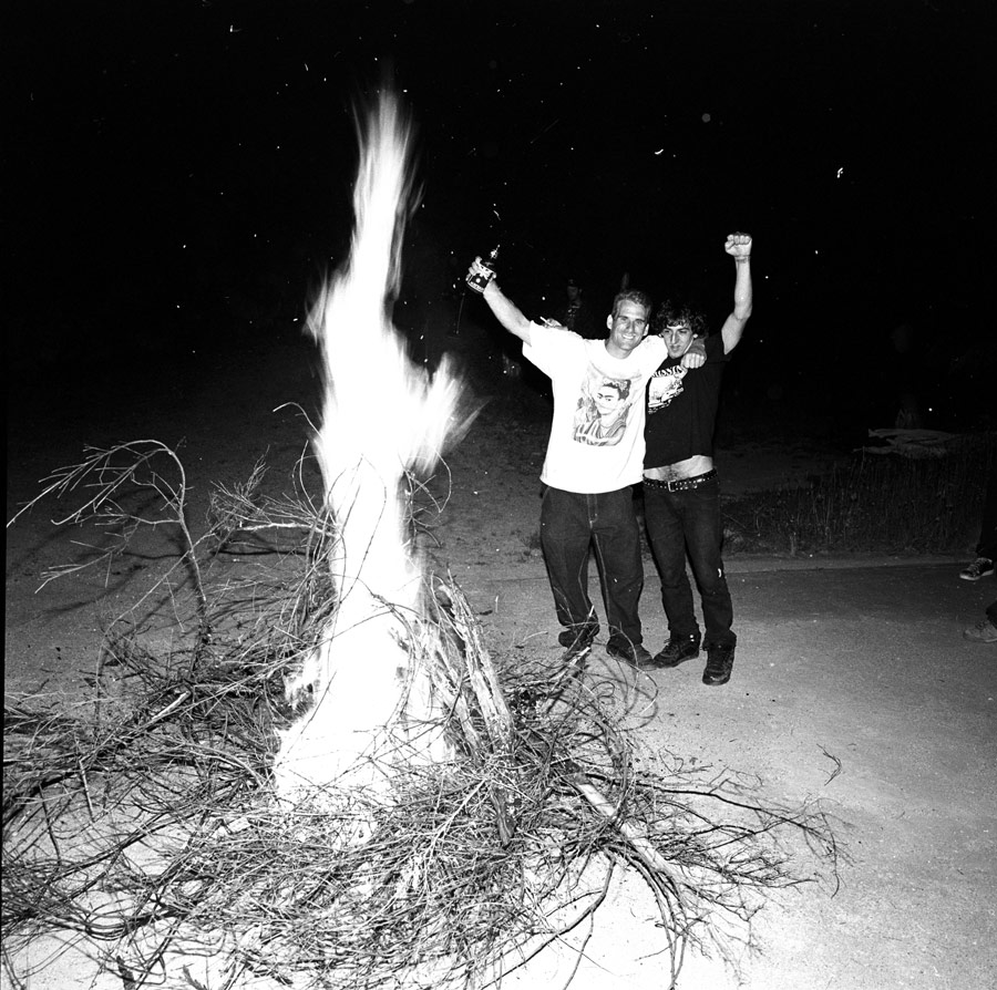 Frank Gerwer and John Cardiel make a fire to party.