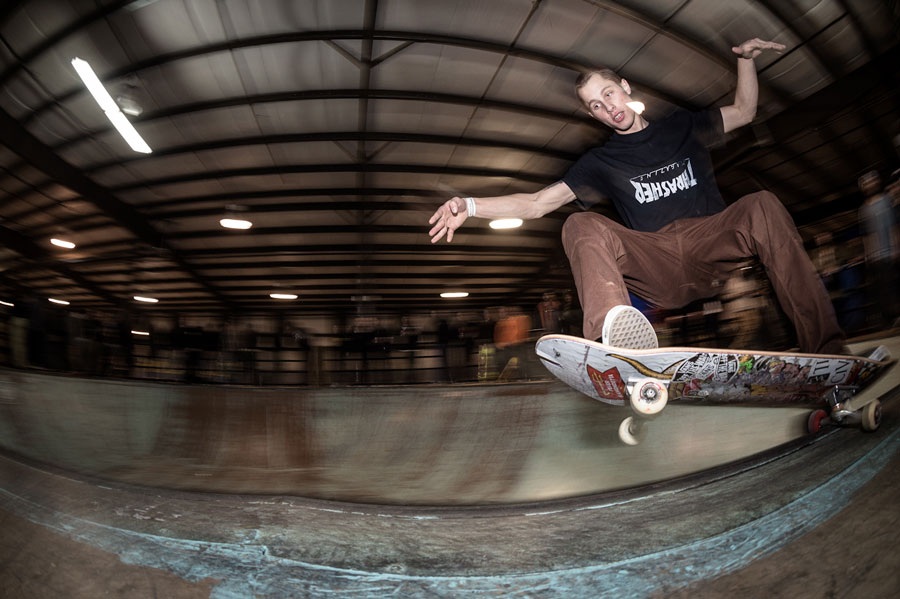 Justin Healey from Civil Skateshop cruises one across the coping.