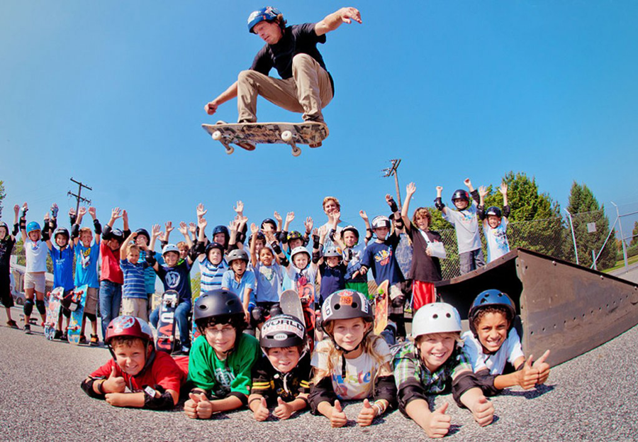 Gary Smith airing over kids at the summer skate camp he runs through Vu Skateshop